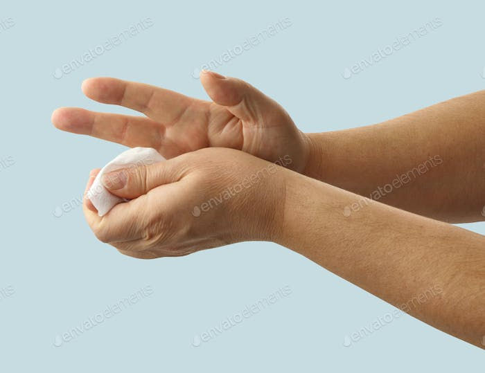 hands are cleaned with a disinfectant wipe