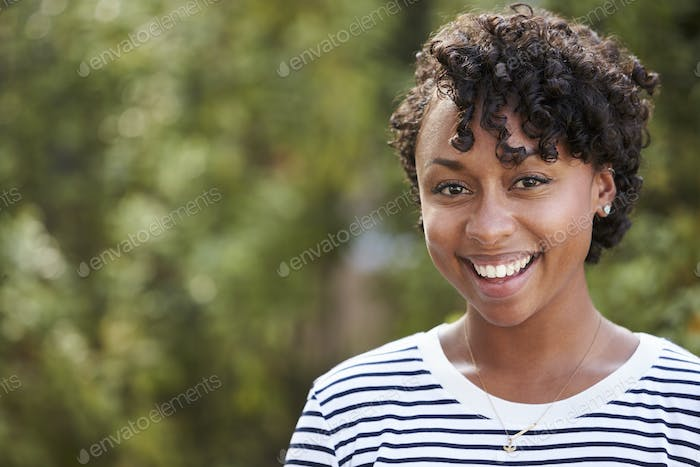 Smiling young African American woman, head and shoulders
