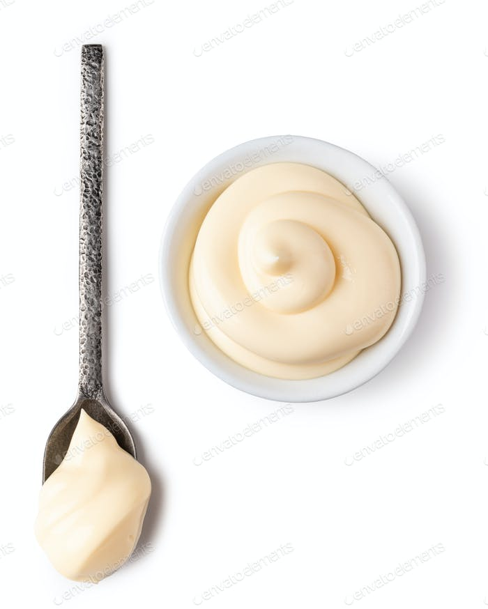 Bowl and spoon with mayonnaise