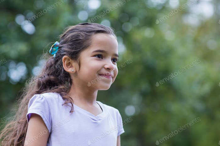Little girl smiling on a sunny day