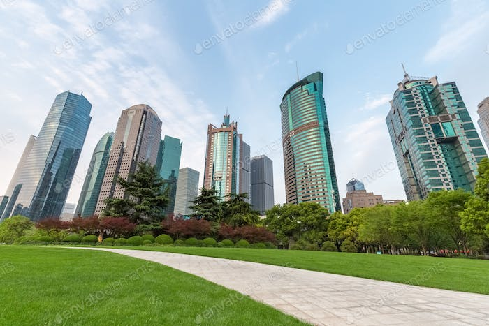 modern building with city park and footpath in shanghai