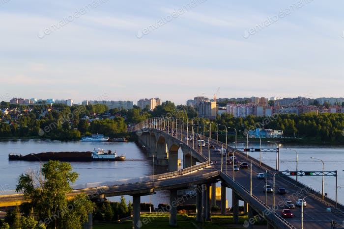 Summer city landscape with a bridge over the river