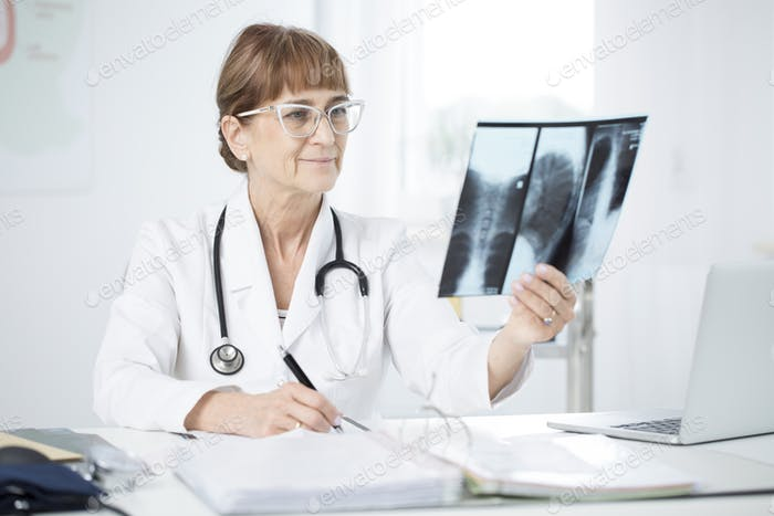 Pulmonologist looking at X-ray picture