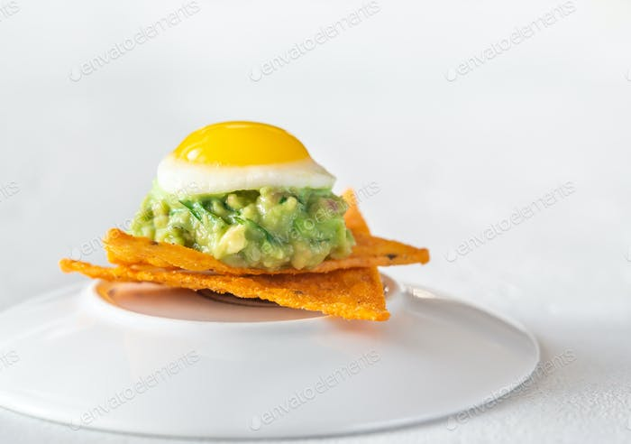Guacamole and  quail egg appetizer
