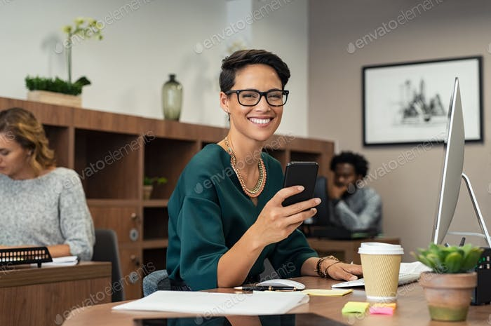Stylish business woman using smartphone