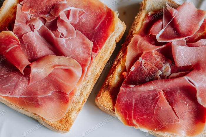 Toasts with serrano ham, traditional spanish breakfast