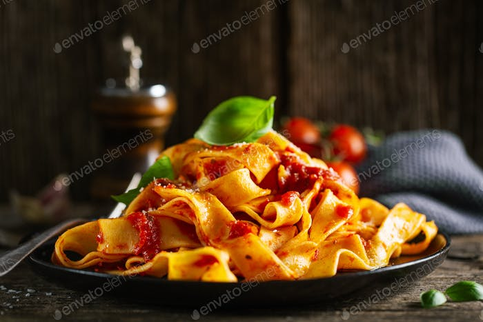 Tasty italian pasta with tomato sauce and parmesan