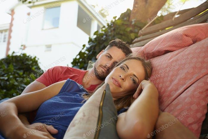 Romantic couple in garden hammock together