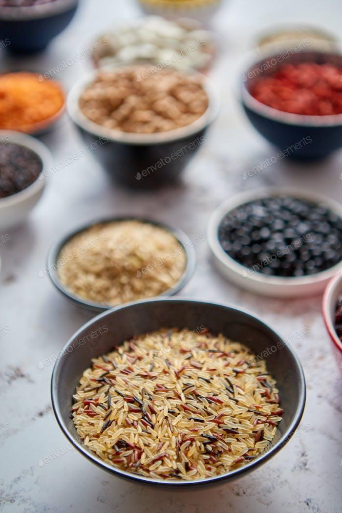 Raw lentil seeds in ceramic bowl. Selective focus