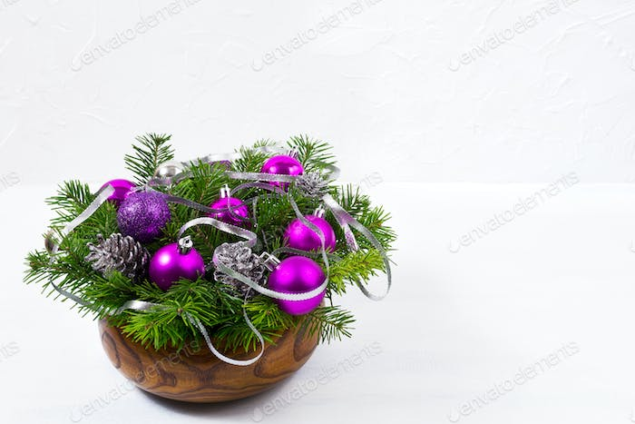 Christmas centerpiece with glitter and purple baubles, copy spac