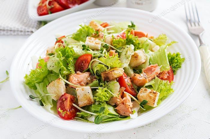 Caesar Salad with Salmon. Fish menu. Seafood - salmon.