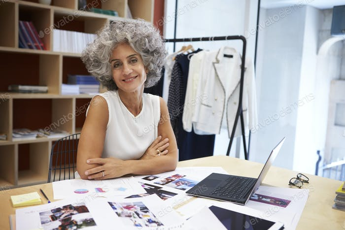 Senior female media creative in office looking to camera