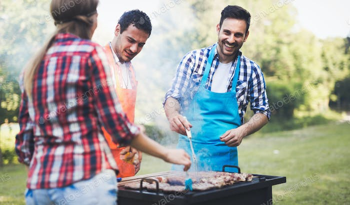 Happy people having camping and having bbq party