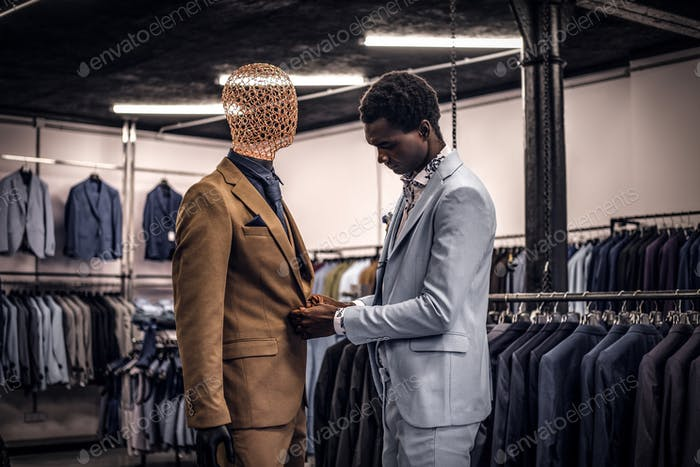 Handsome elegantly dressed African-American man in a classic menswear store