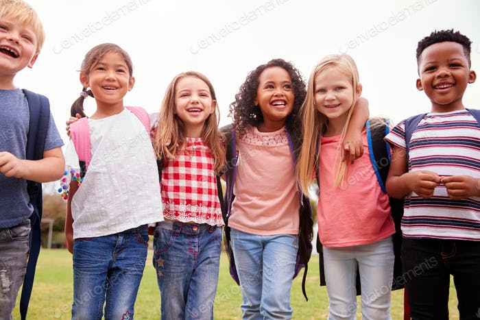 Portrait Of Excited Elementary School Pupils On Playing Field At Break Time