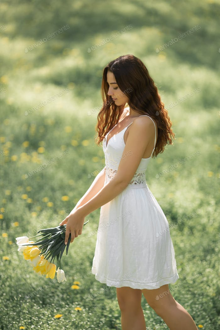 Woman with Bouquet of the Spring Flowers Outdoors