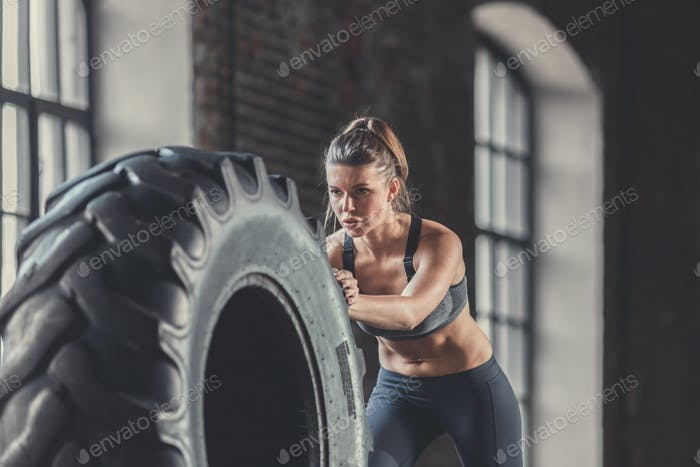 Sports woman with a wheel