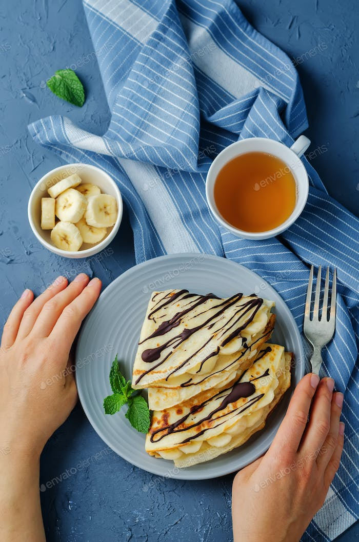Crepes with fresh banana slaces and dark chocolate