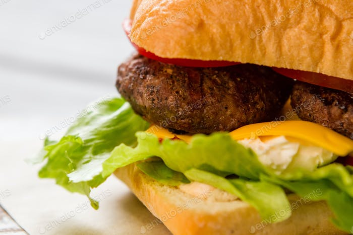 Burger with lettuce leaves