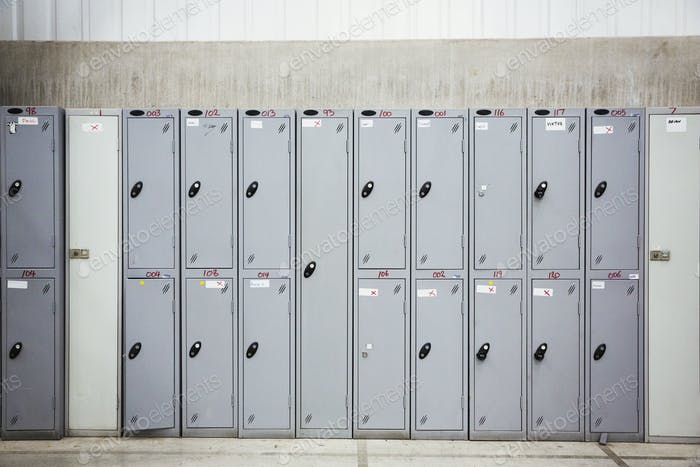 A row of grey metal lockers in a bicycle factory.
