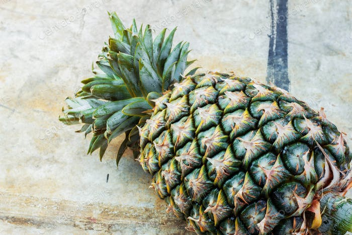 Pineapple on the old floor