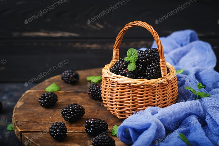 Summer berry on table. Healthy lifestyle concept, blackberries in basket