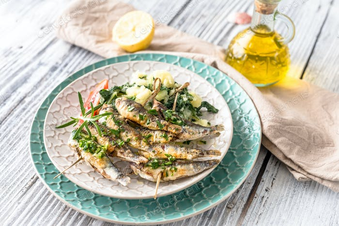 Healthy sardines with potato and chard