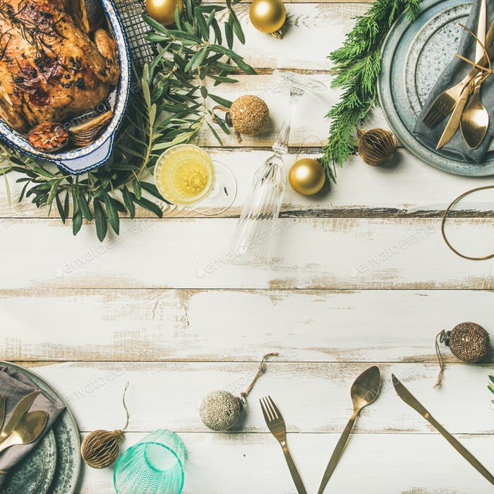 Christmas or New Year celebration table setting with roasted chicken