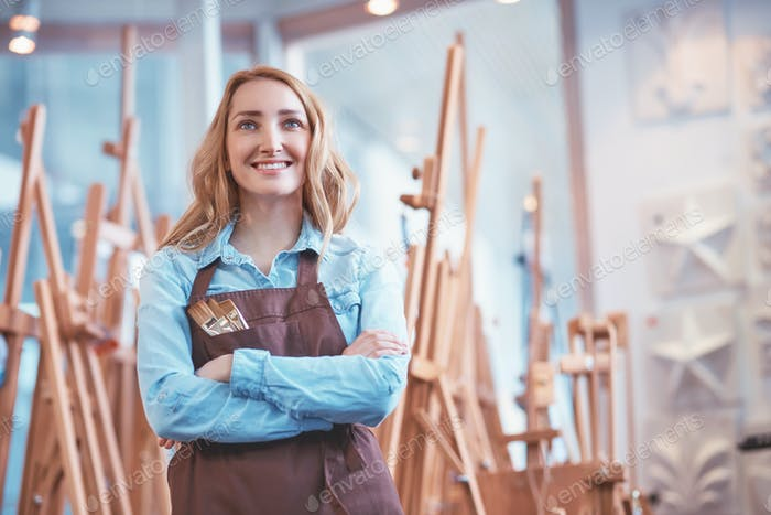 Smiling artist at easels