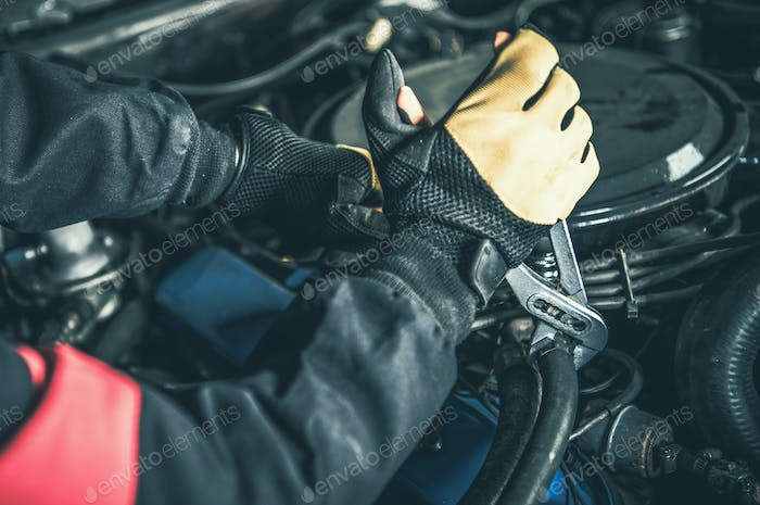 Car Mechanic Working with Gasoline Engine Problem