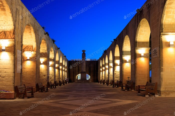 Valletta, Malta, Upper Barrakka Gardens. Illuminated stone arches in the evening