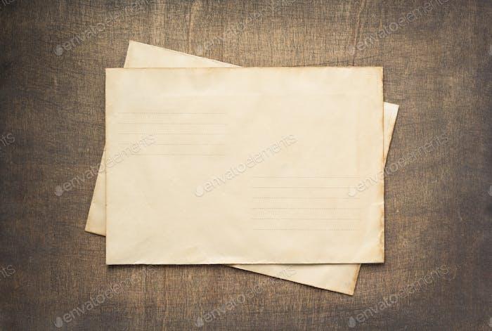 old retro postal envelope at wood