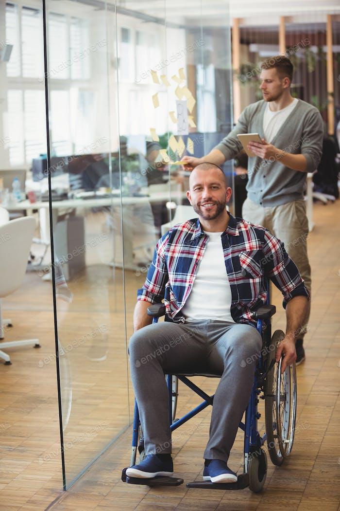 Smiling handicap businessman in creative office