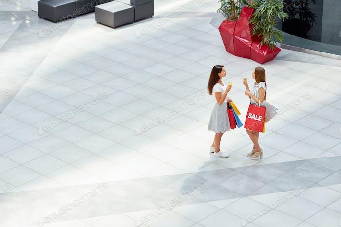 Girlfriends in Shopping Center
