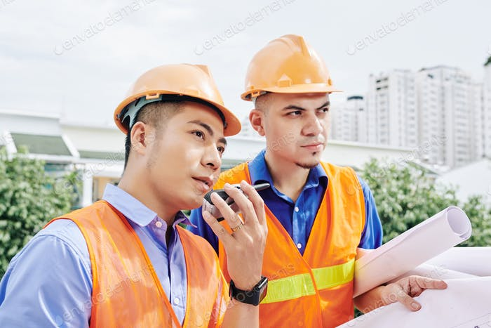 Contractor using walkie-talkie-talkie for communication