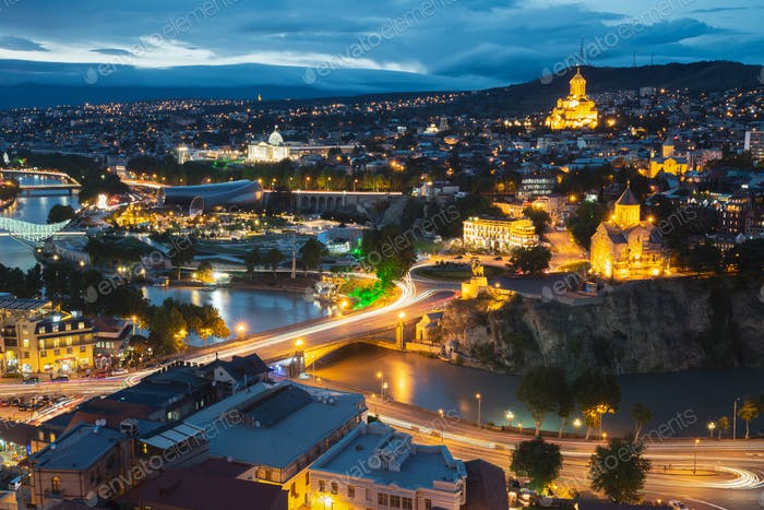 Tbilisi, Georgia. Evening Night View Of Georgian Capital Skyline. Scenic Top View Of Summer Evening