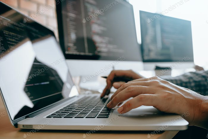 contemporary website developer man typing and writing code for program website