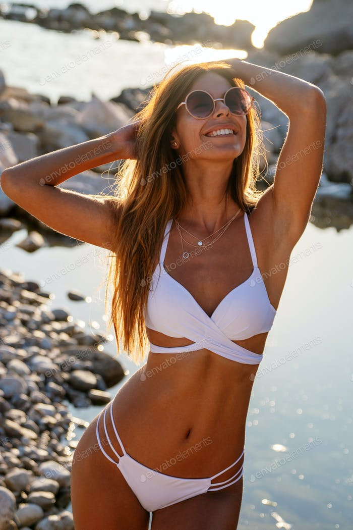 Beautiful sexy woman in bikini at the beach summer vacation