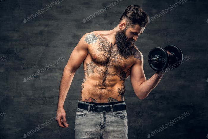 Shirtless bearded male with tattooed torso doing workout  with d