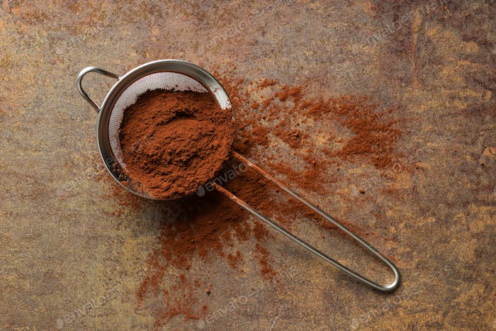 Cocoa powder in a sieve.