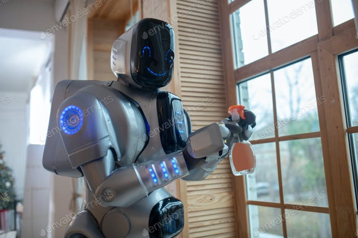 Robot cleaning the window in the kitchen