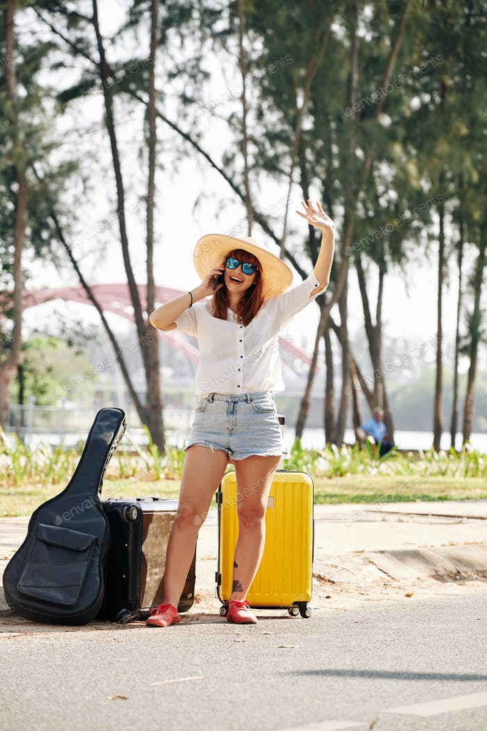 Female traveler trying to chatch car