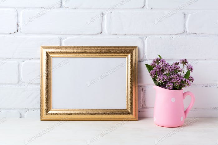 Golden  landscape frame mockup with purple flowers in pink rusti