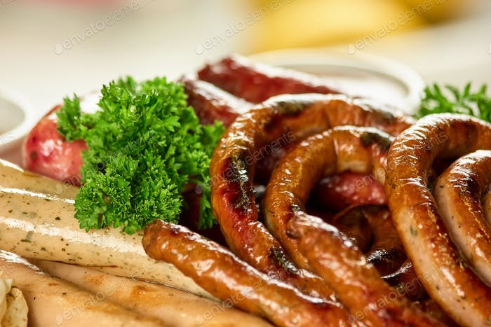 Curly and straight sausages with parsley.