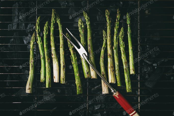 Grilled asparagus on charcoal