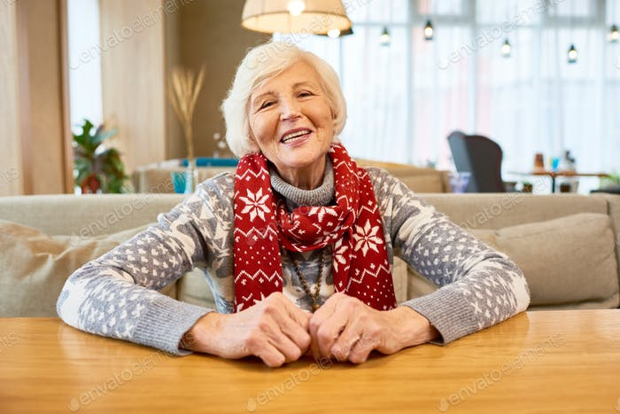 Happy Grandmother Wearing Christmas Scarf