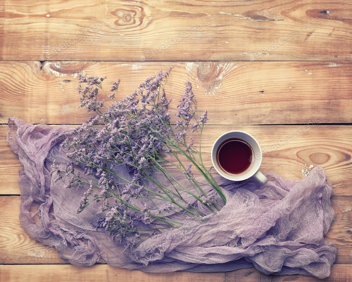 Black tea with meadow flowers wrapped in colored purple gauze