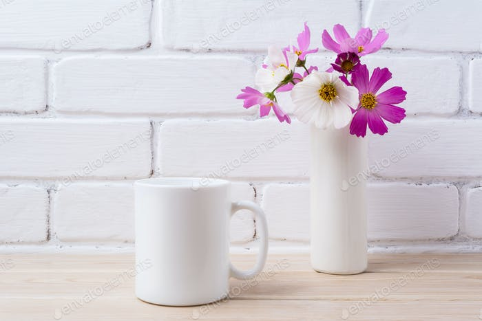 White coffee mug mockup with white and pink daisy