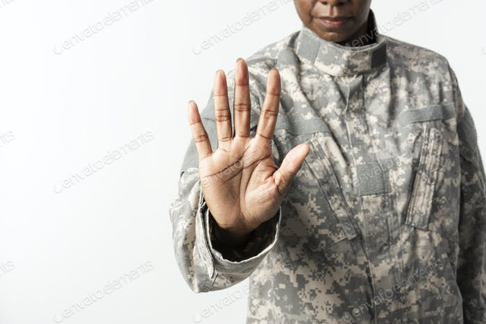 Female soldier with hand gesture