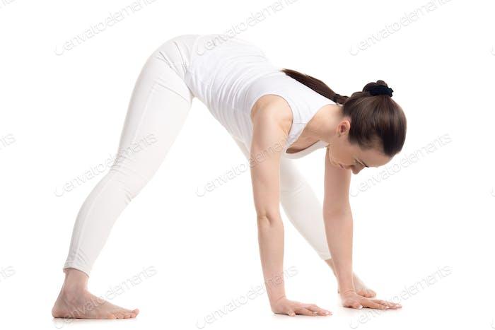 Yogi female doing Standing Straddle Forward Bend